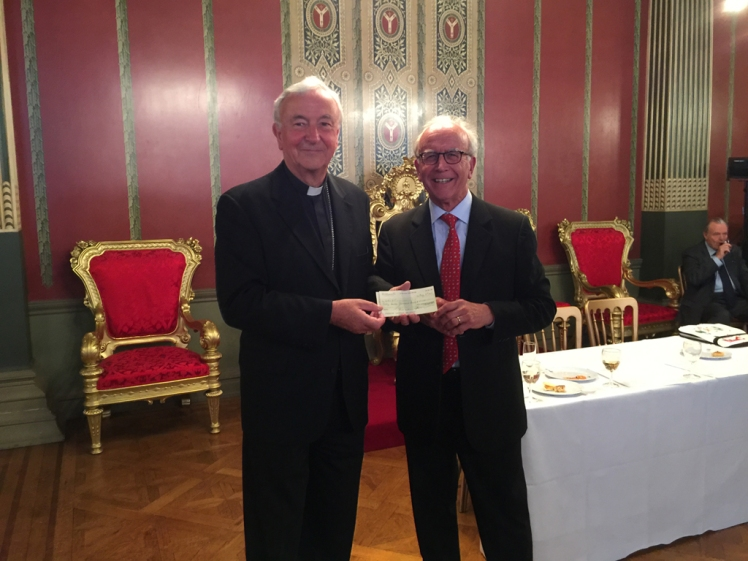Cardinal and Chairman with this year's cheque